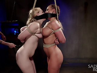 Two curvy slaves are bound number other on every side the hottest BDSM session