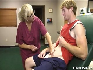 Mature nurse knows how to make her patiend uncovered his balls