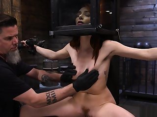 Shackled redhead lackey is toyed