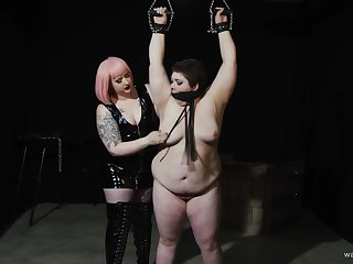 Chubby dyke's painful and pleasurable Lezdom set-to with a curvy Domme