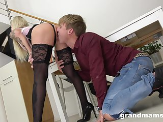 Mature mistress puts on strapon and fucks anal hole of young gigolo
