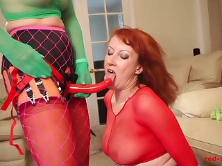 Redhead mature Red gets fucked away from a strap on