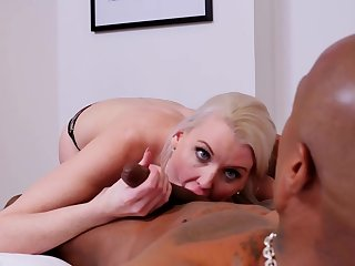 Experienced blonde milf is sucking a big, black meat stick, while acquiring her pussy licked