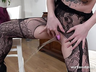 Pretty coloured haired Kira Axe wears morose lingerie and masturbates her wet pussy