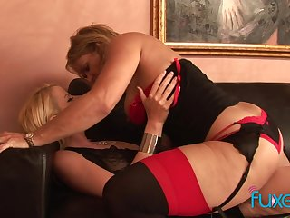 Curvaceous temptress of a MILF fucks a attracting young woman with a strap-on
