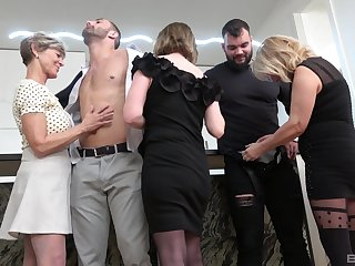Insolent matures undress together with share the lad's big dicks in a crazy habitation orgy